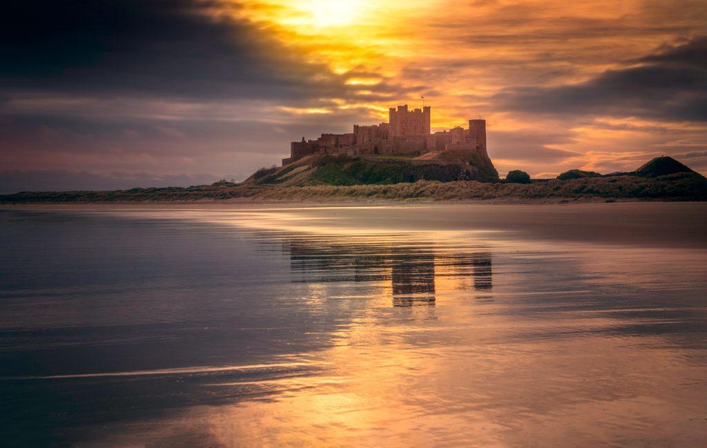 castle-near-body-of-water-under-golden-hour-1843364