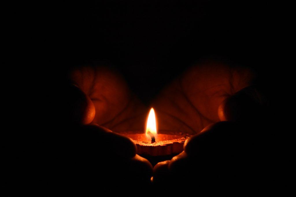 tealight-candle-on-human-palms-783200